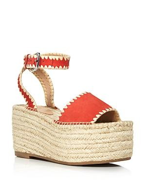 b0aaea2117a A super-chunky espadrille platform keeps you in a warm-weather mood when  you wear this raffia-stitched sandal secured by a floating ankle strap.