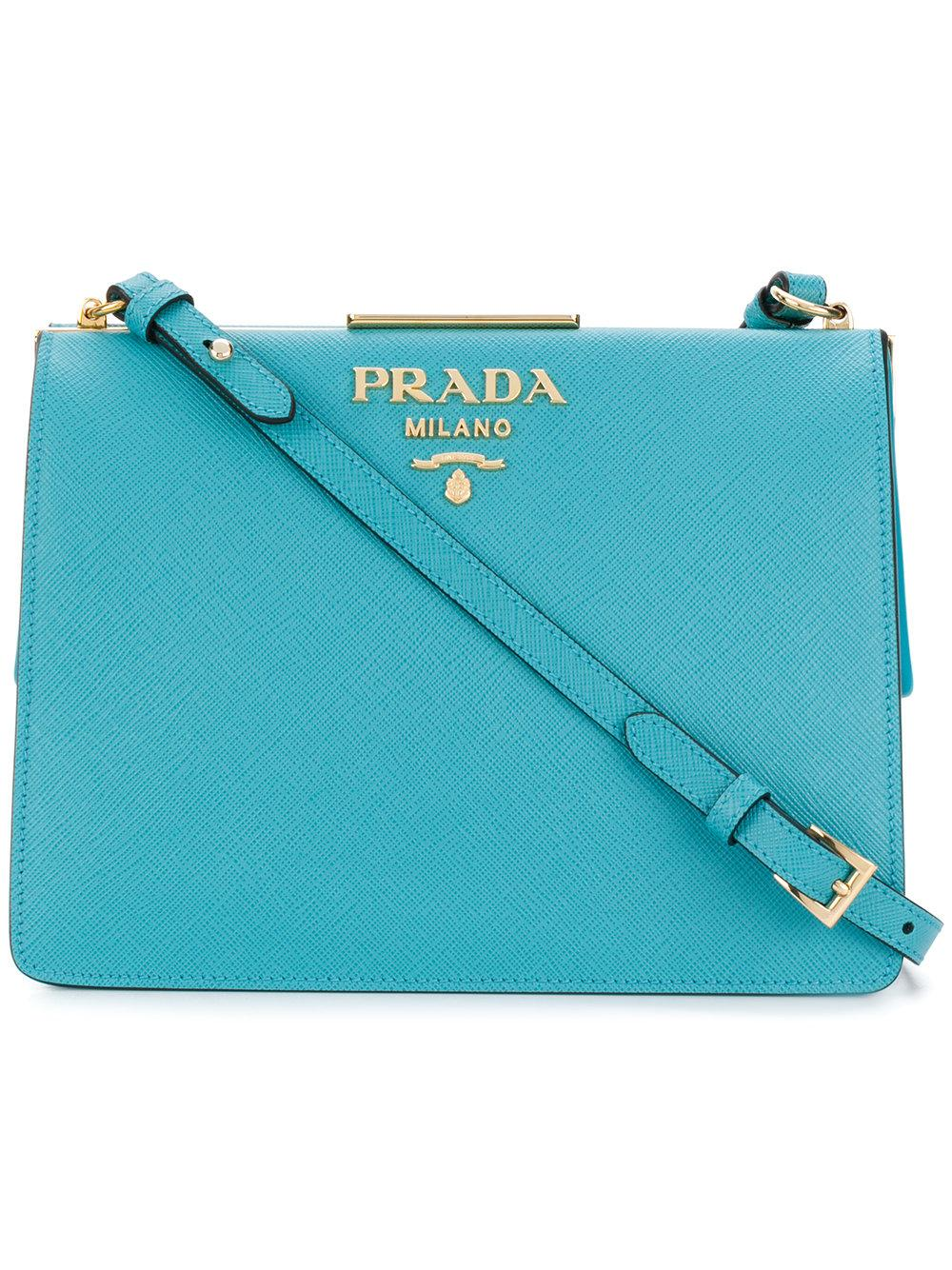 Fashioned in Italy from Prada s signature light blue Saffiano calf leather afd061835ce54