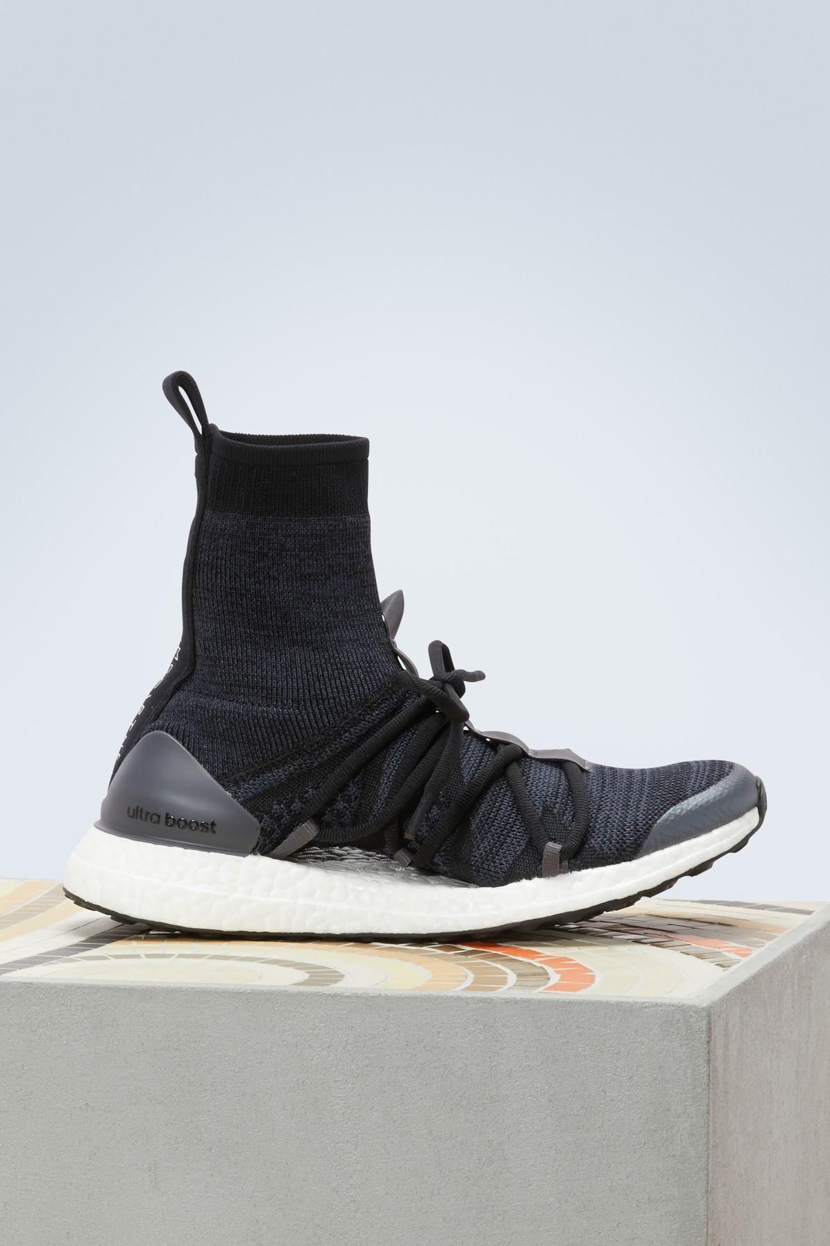 f075023e7eb76 ADIDAS BY STELLA MCCARTNEY. Ultraboost X Mid Sneakers in Core Black Night  Grey Night Steel-Smc