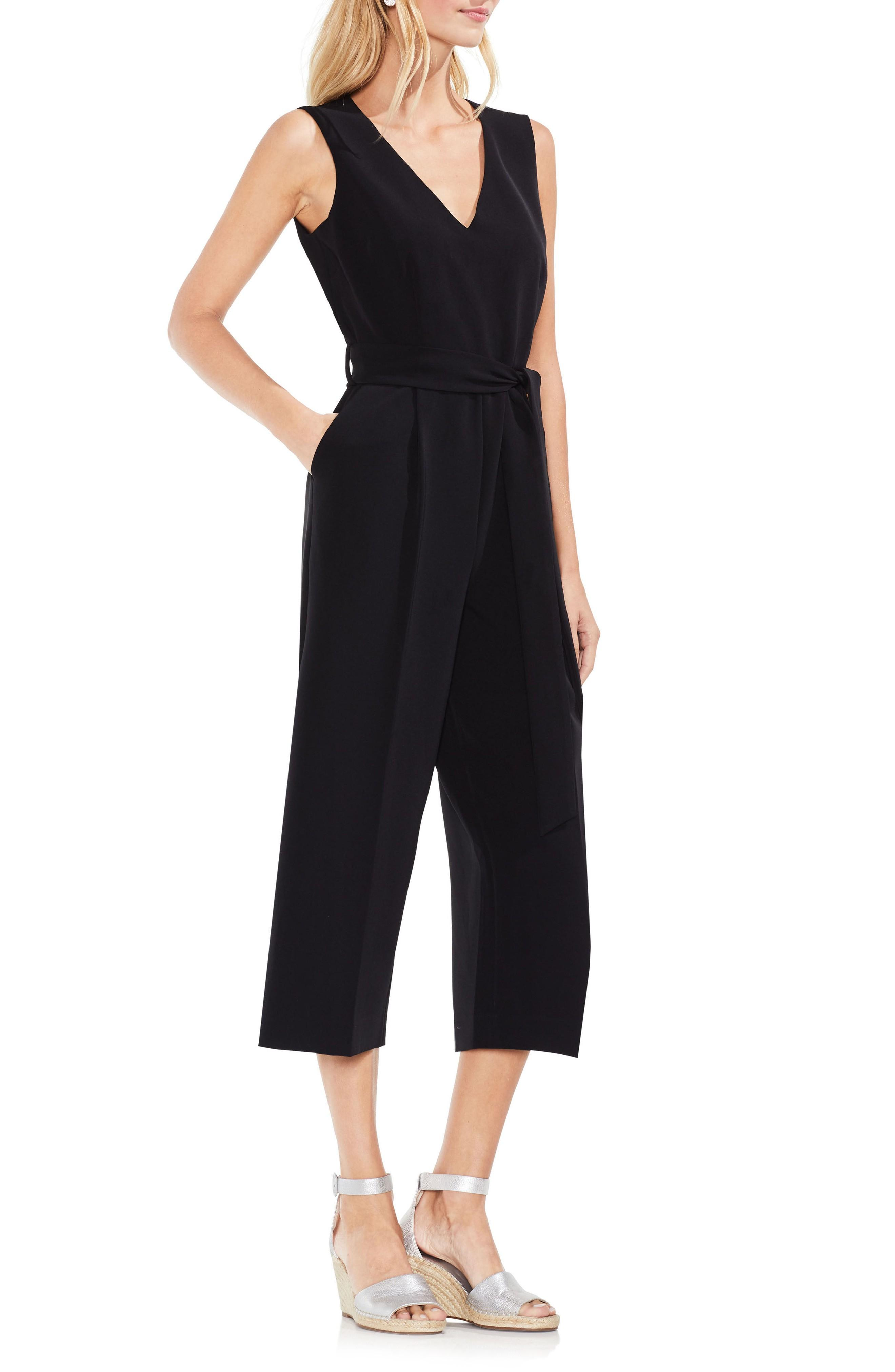 100584e257a2 Boast a sleek silhouette in this easy-to-wear jumpsuit styled with a  flattering V-neck