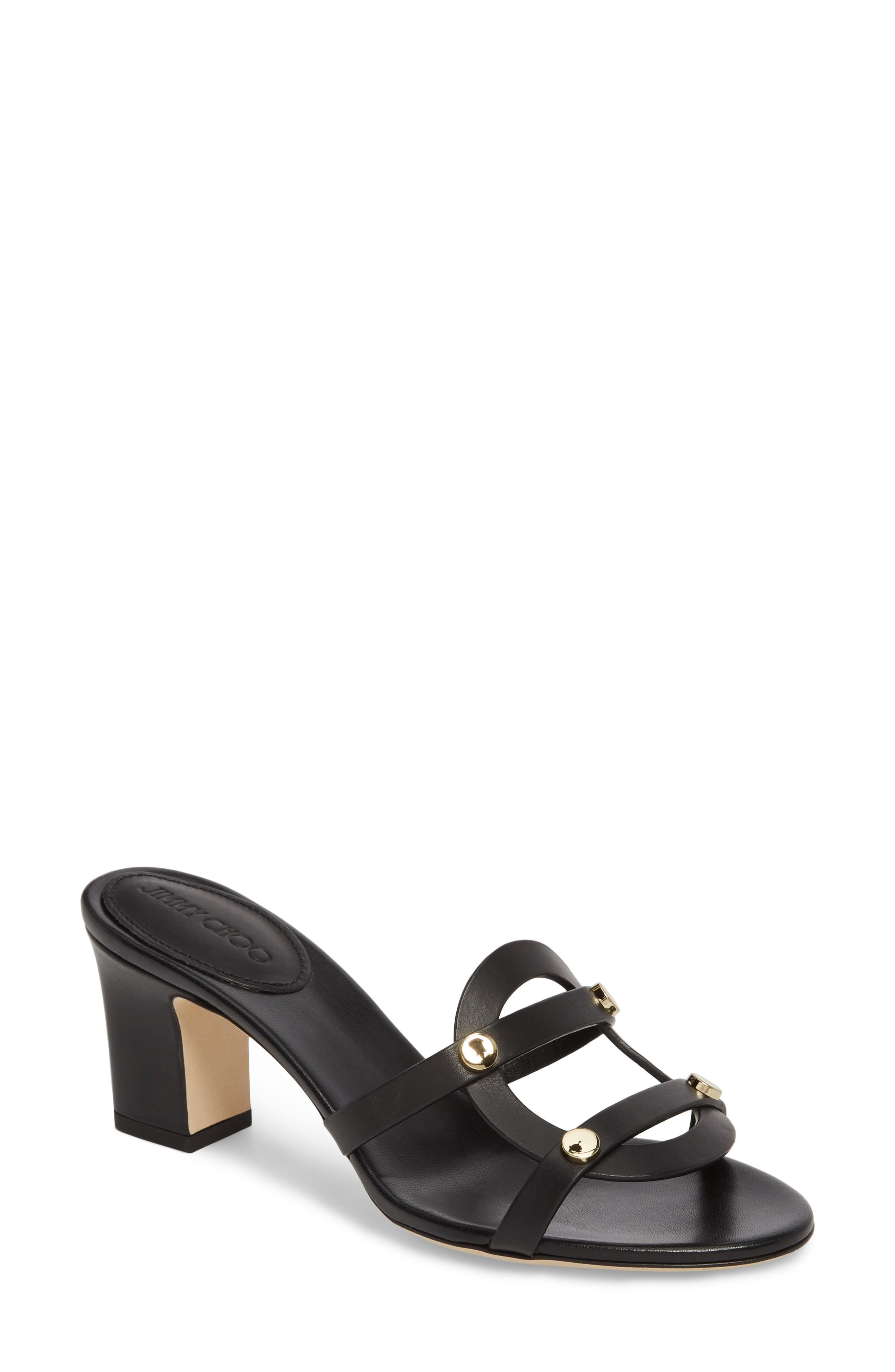 ea2948275ef Sculptural lines and gleaming hardware define a chic slide sandal grounded  by a chunky block heel. Style Name  Jimmy Choo Damaris Block Heel Sandal ( Women).