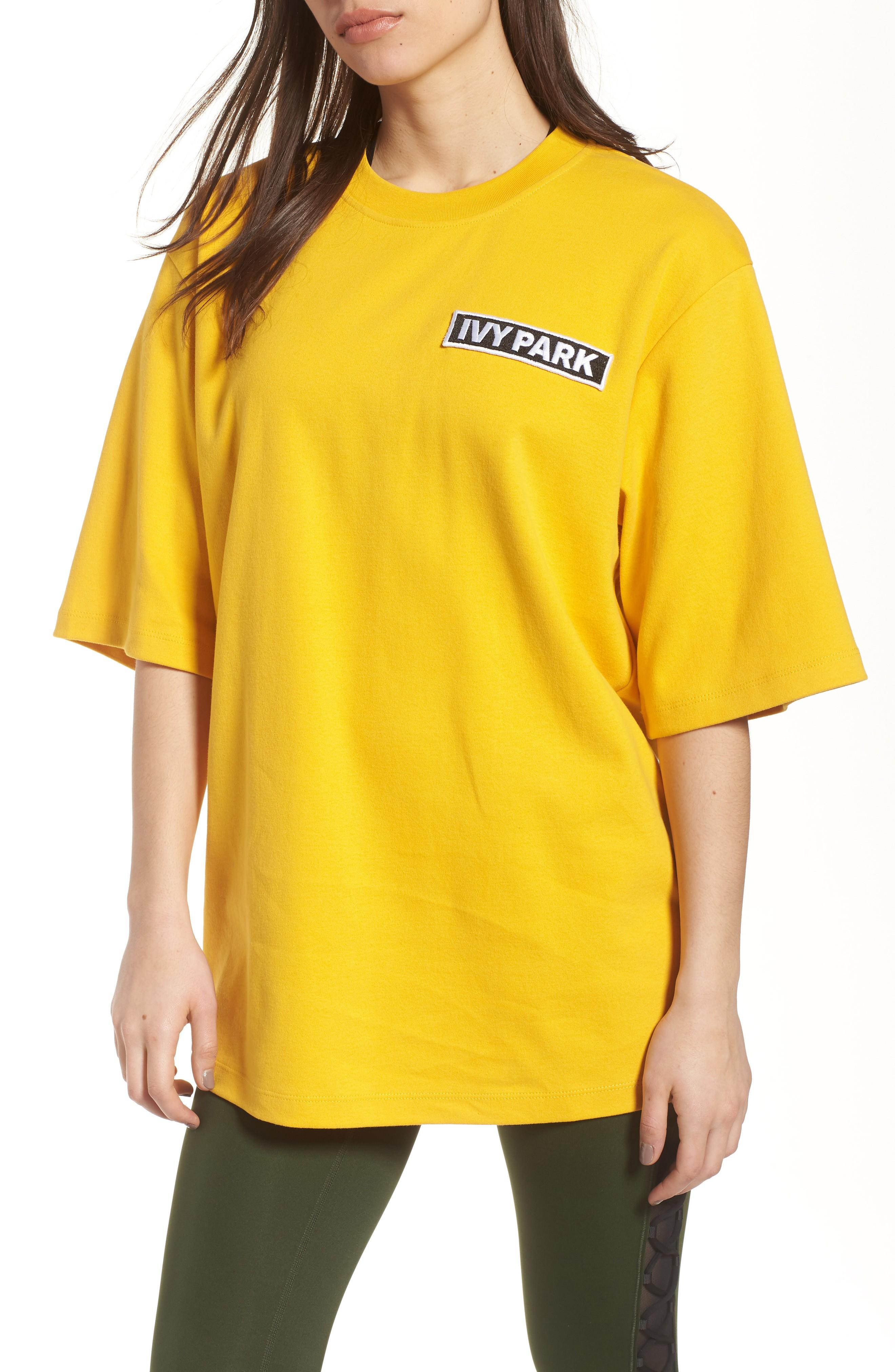 Ivy Park Flag Badge Tee In Old Gold