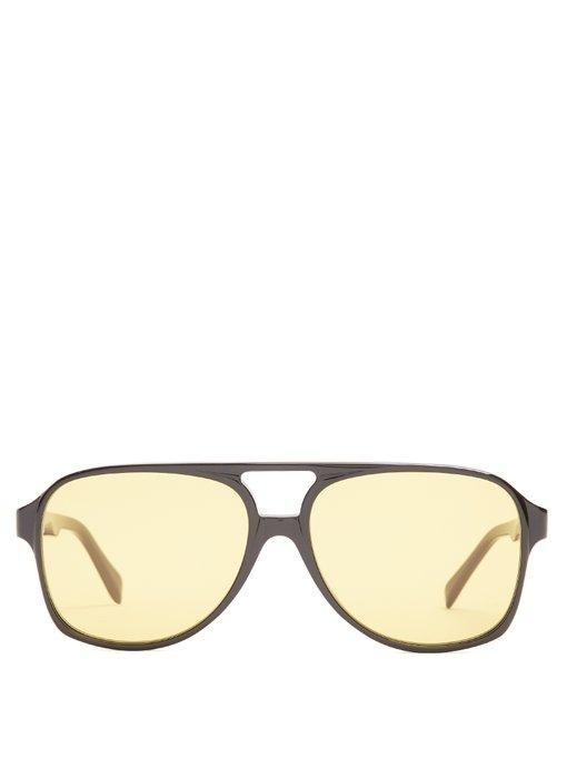 bf4c50246957 Yellow tinted frames lend a contemporary note to Céline s pared-down black  Navigator acetate sunglasses. They re made in Italy with modern  aviator-style ...