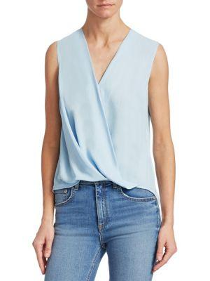 ab0aec509c65c ... Rag   Bone s Victor blouse will seamlessly transition from day-to-night  styling thanks to its sleeveless profile and sleek cross-over front.