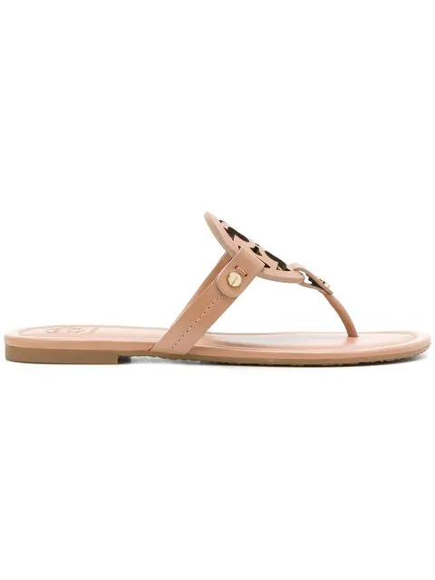 4617bfe77e87 Tory Burch Miller Medallion Metallic Leather Flat Slide Sandal In 216 Light  Makeup. SIZE   FIT INFORMATION
