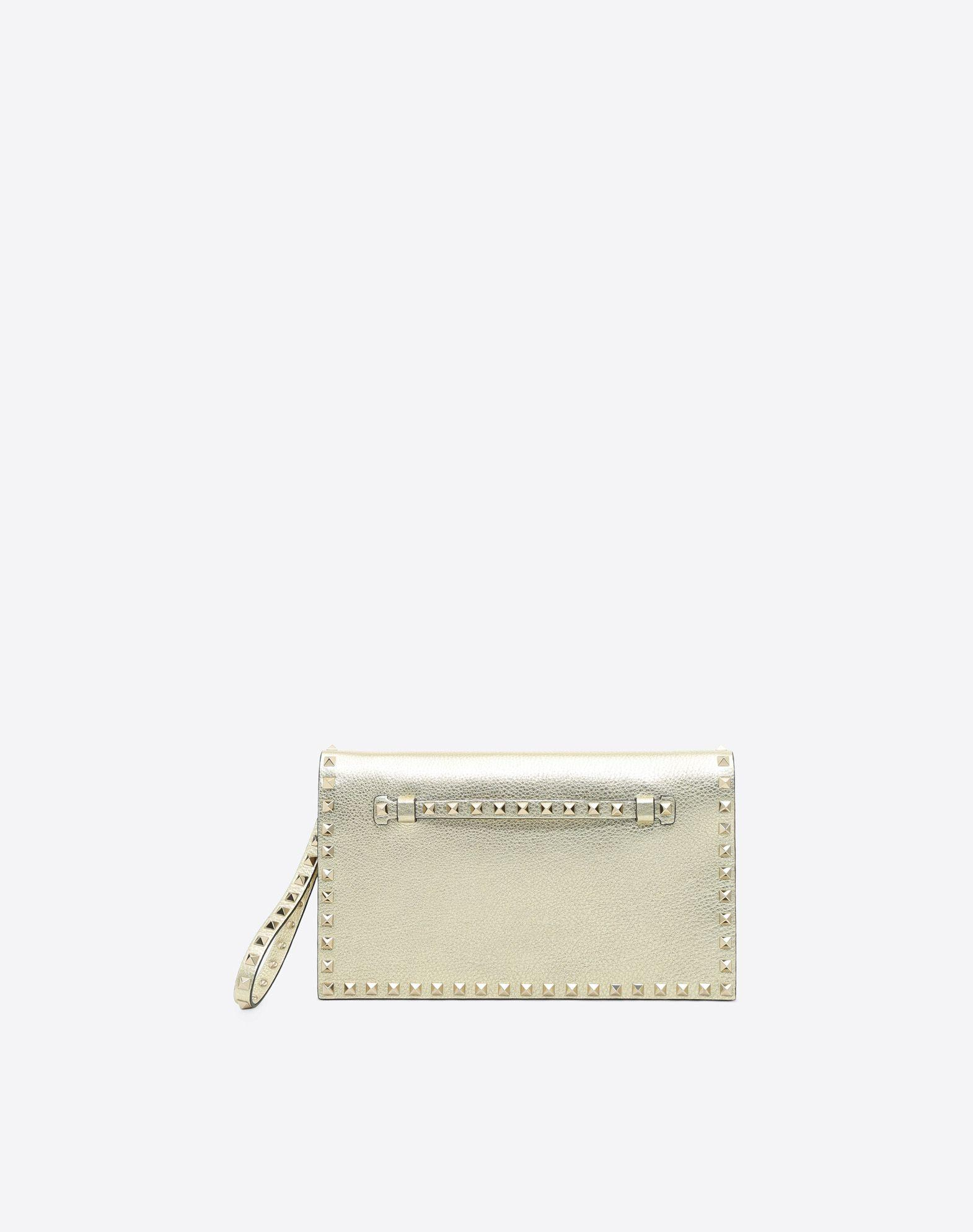 15b9d4eac3 Valentino Rockstud Clutch In Gold | ModeSens