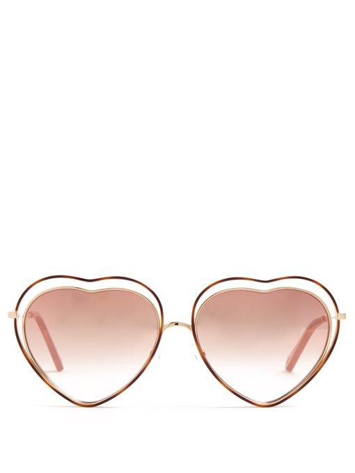 e6d7e8a76c The heart-shaped frames of Chloé s brown Poppy sunglasses are a nod to  1970s styles. They re crafted in Italy with a gold-tone metal inner frame  and temples ...