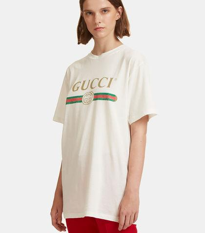 df7fad653 Gucci Logo Print Faded Cotton T-Shirt In Black | ModeSens