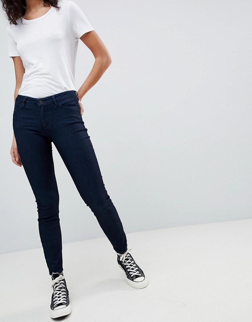 3934f63c5b5d Armani Exchange Super Skinny Low Rise Jeans - Blue | ModeSens