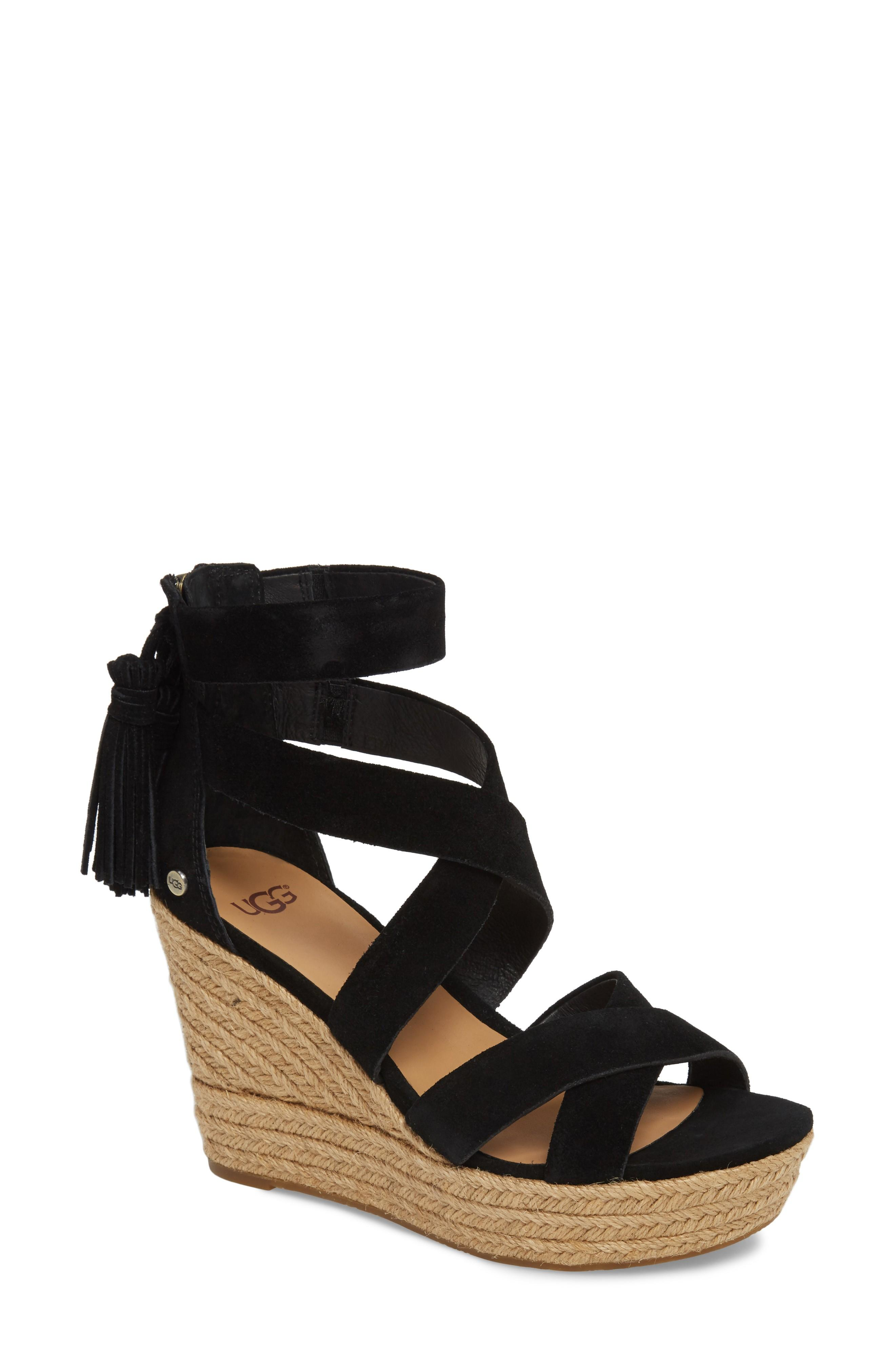 06ba1681e01 A trio of tassels swing and sway with your every step in this strappy sandal  lofted skyward by a towering wedge heel and platform. Style Name  Ugg  Raquel ...