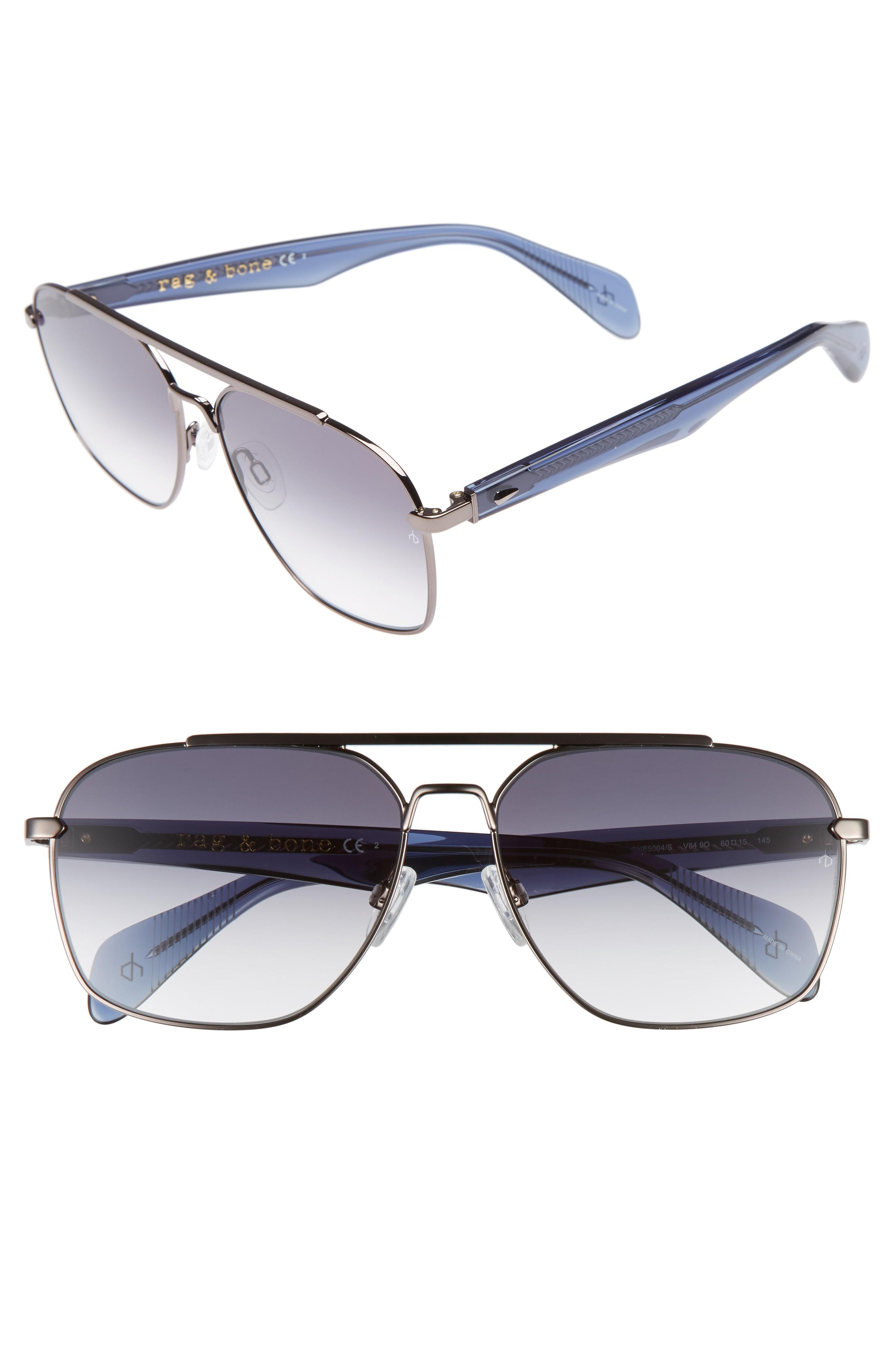 3aeb76bad13 A double bridge and square wire frames further the timeless style of  navigators fronted with dark gradient lenses that offer complete UV  protection.