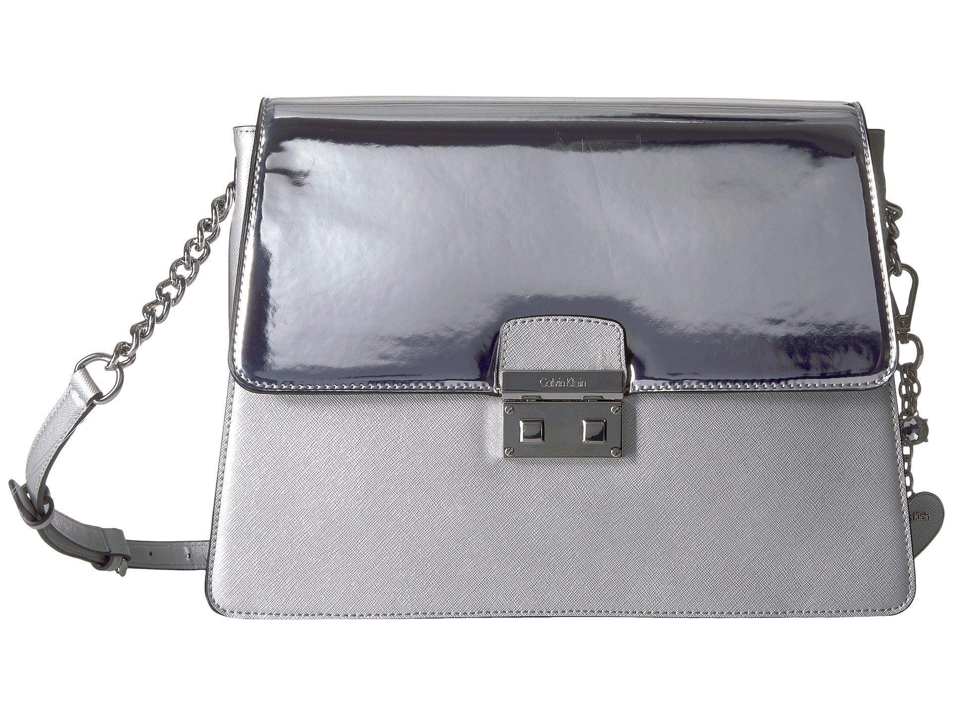 4d641bf5e3f Calvin Klein Mirrored Large Flap Crossbody In Metallic Silver | ModeSens