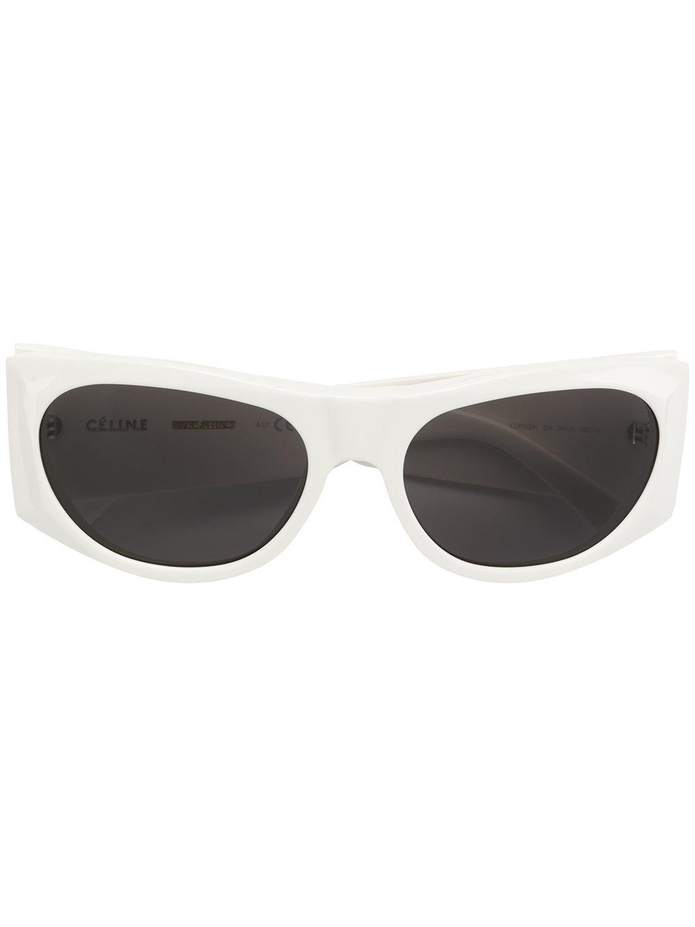 f142438ba749 White oval sunglasses from Céline Eyewear featuring dark tinted lenses