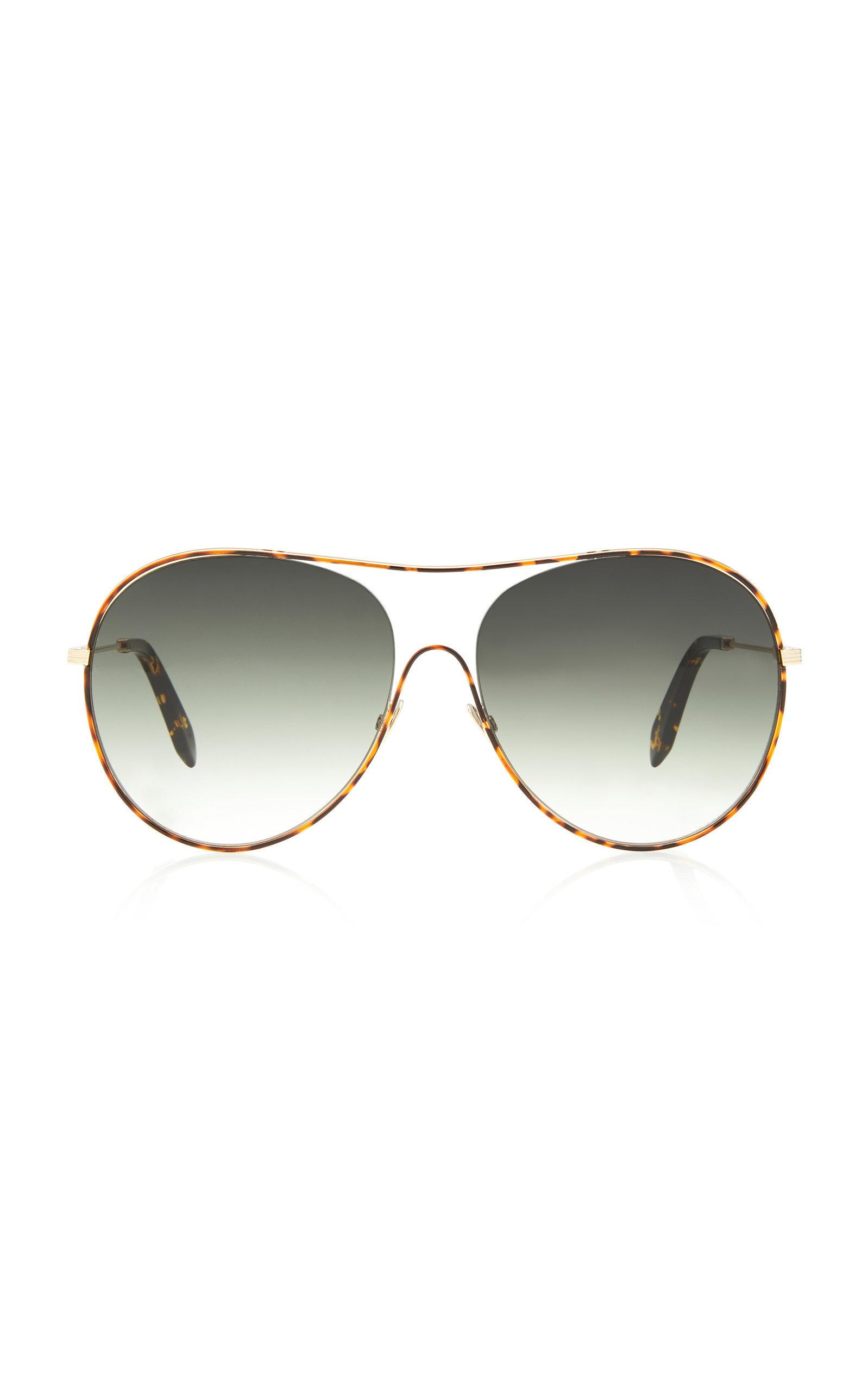 ff0a9ed15c69 Victoria Beckham s round-frame sunglasses are crafted from acetate in an  oversized silhouette. Designed with gold-toned metal sides this pair is  fitted with ...