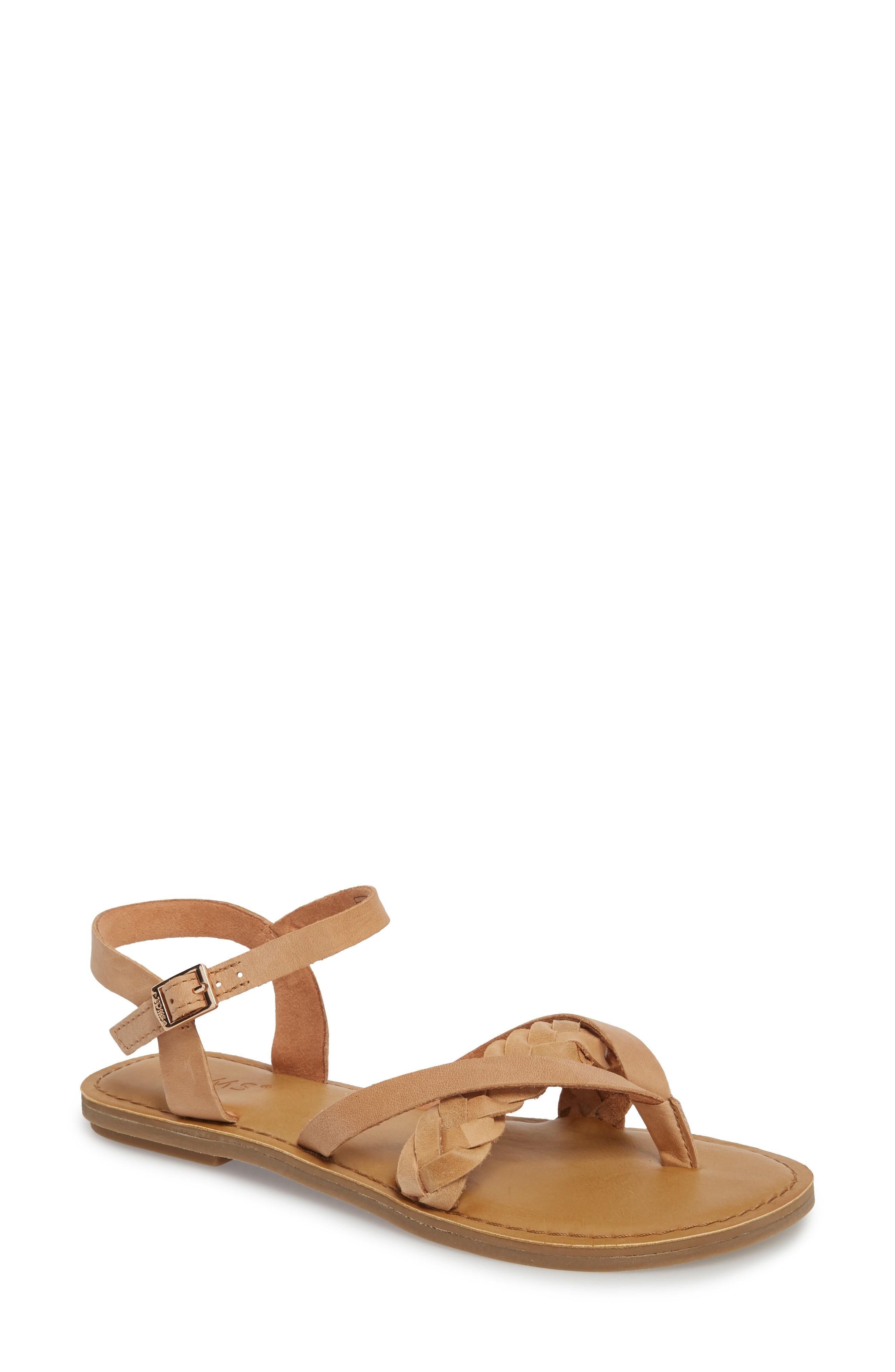52dc121985f A cushy footbed brings comfort to a chic summer sandal accented with a fun
