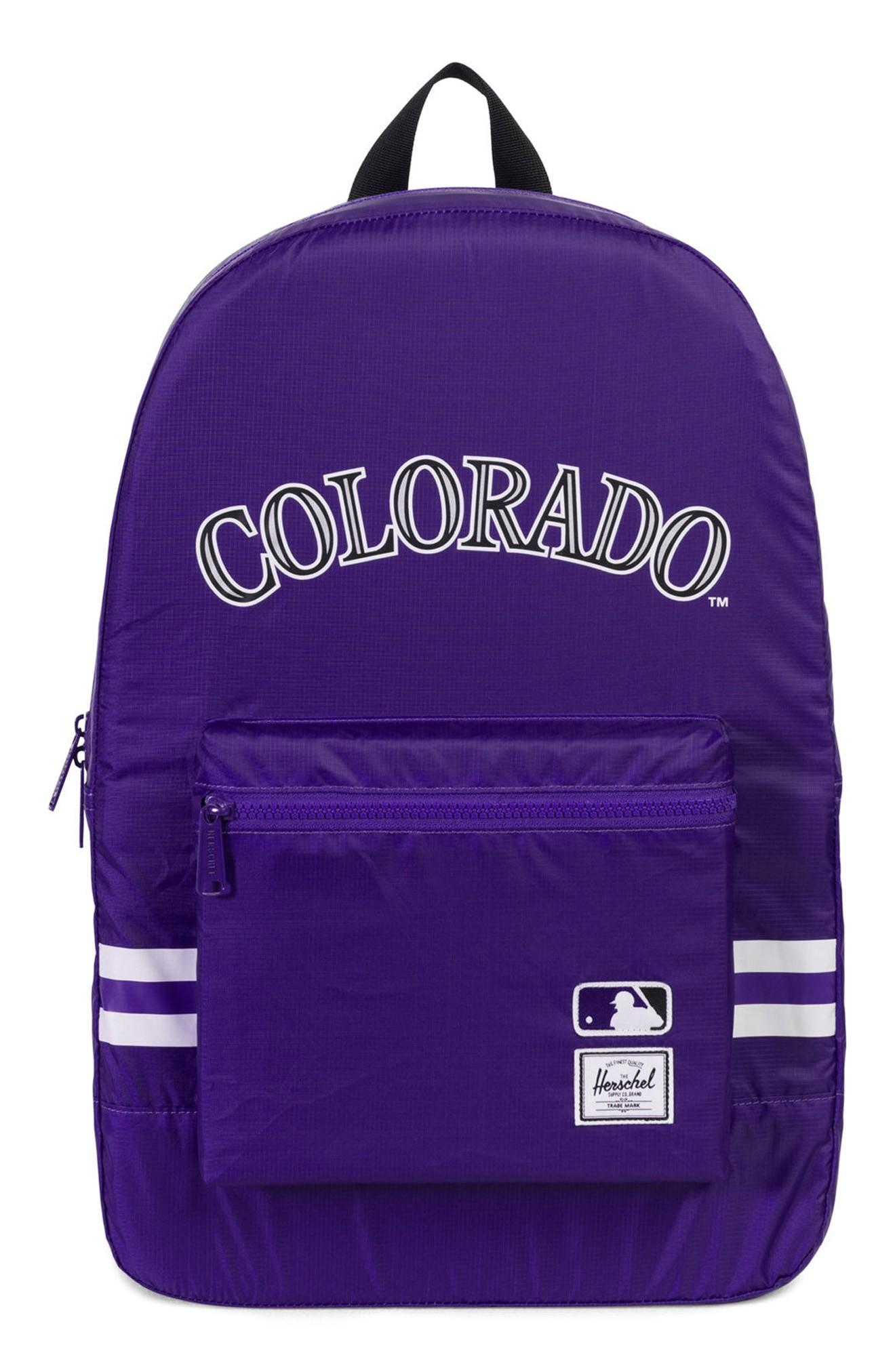 b0c0721750 An ultra-light ripstop backpack printed with your favorite National League  team logos packs down into its own interior pocket when not in use.