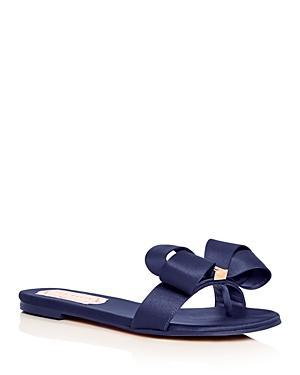 2b33fc9b2fbc A bold bow embellished with logo hardware adds eye-catching sophistication  to a sleek slide sandal. Style Name  Ted Baker London Slide Sandal (Women).