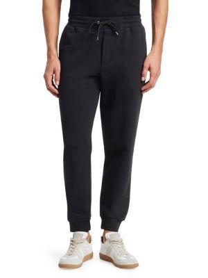 Mcq By Alexander Mcqueen Embroidered Lined Cotton Track Pants In Black