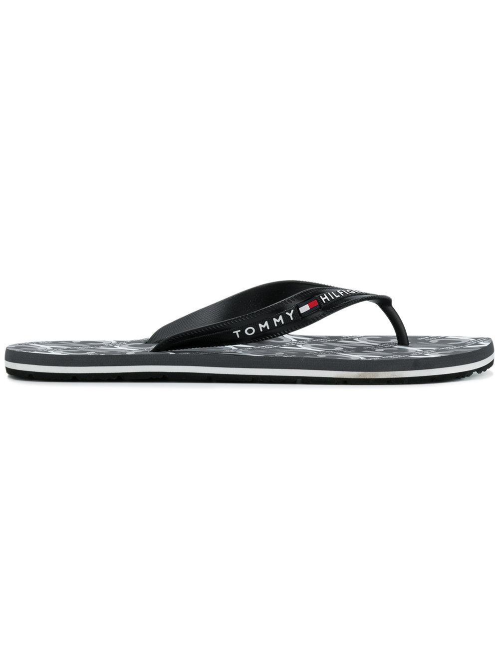 2967d7b1e5b2c7 TOMMY HILFIGER. Tommy Hilfiger Logo Stamped Flip Flops ...