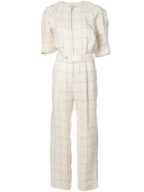 bbd827cd1f8 This  Sea  Delaney Grid Linen Jumpsuit features   Concealed belt button  closure   Relaxed leg   Lining   Composition  100% linen   Color  Cream  Grid   Front ...