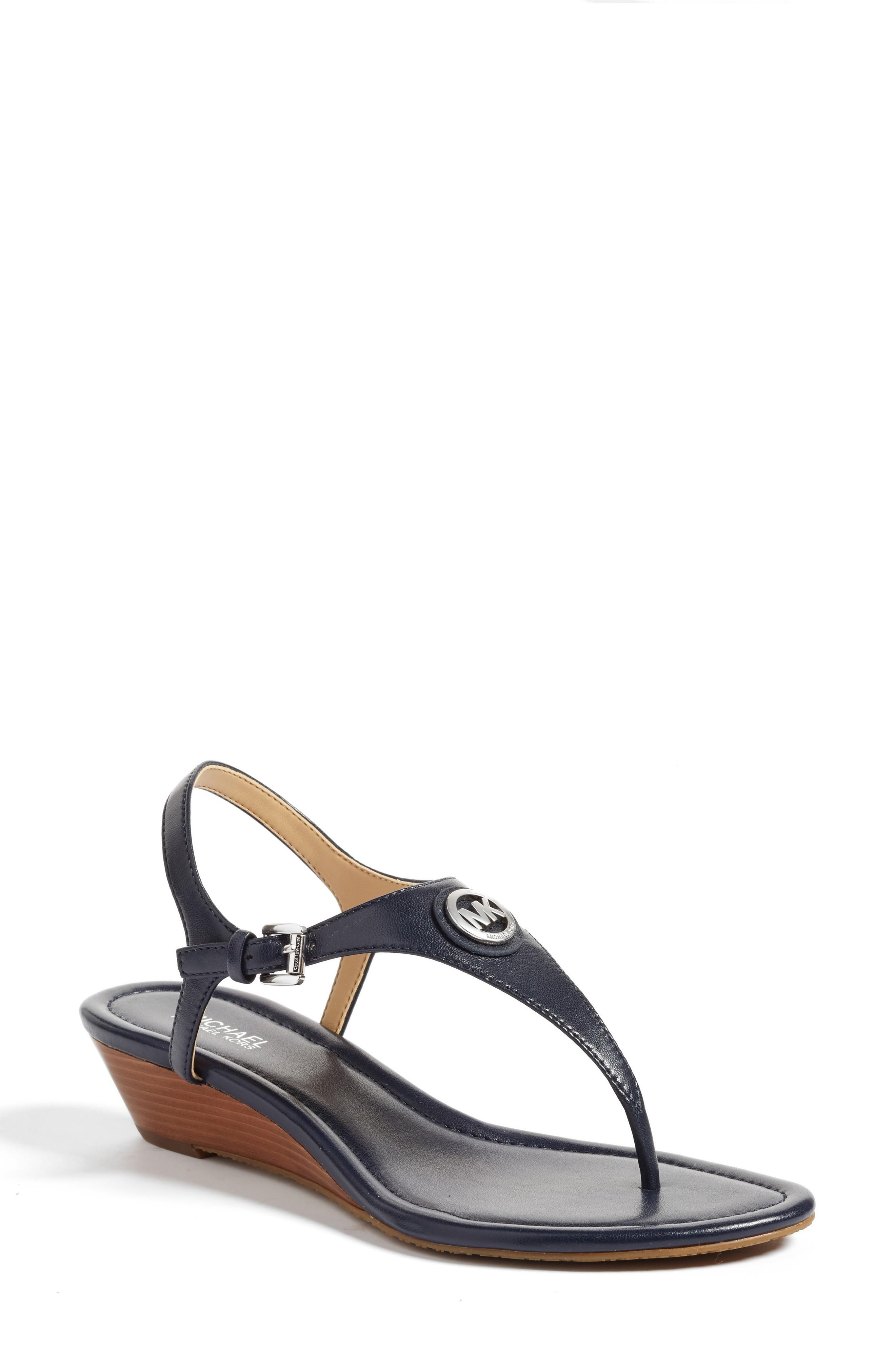 60f013b7f25f Circular logo hardware marks the T-strap of a classic and chic leather  sandal set on a slender stacked wedge. Style Name  Michael Michael Kors   Ramona  ...