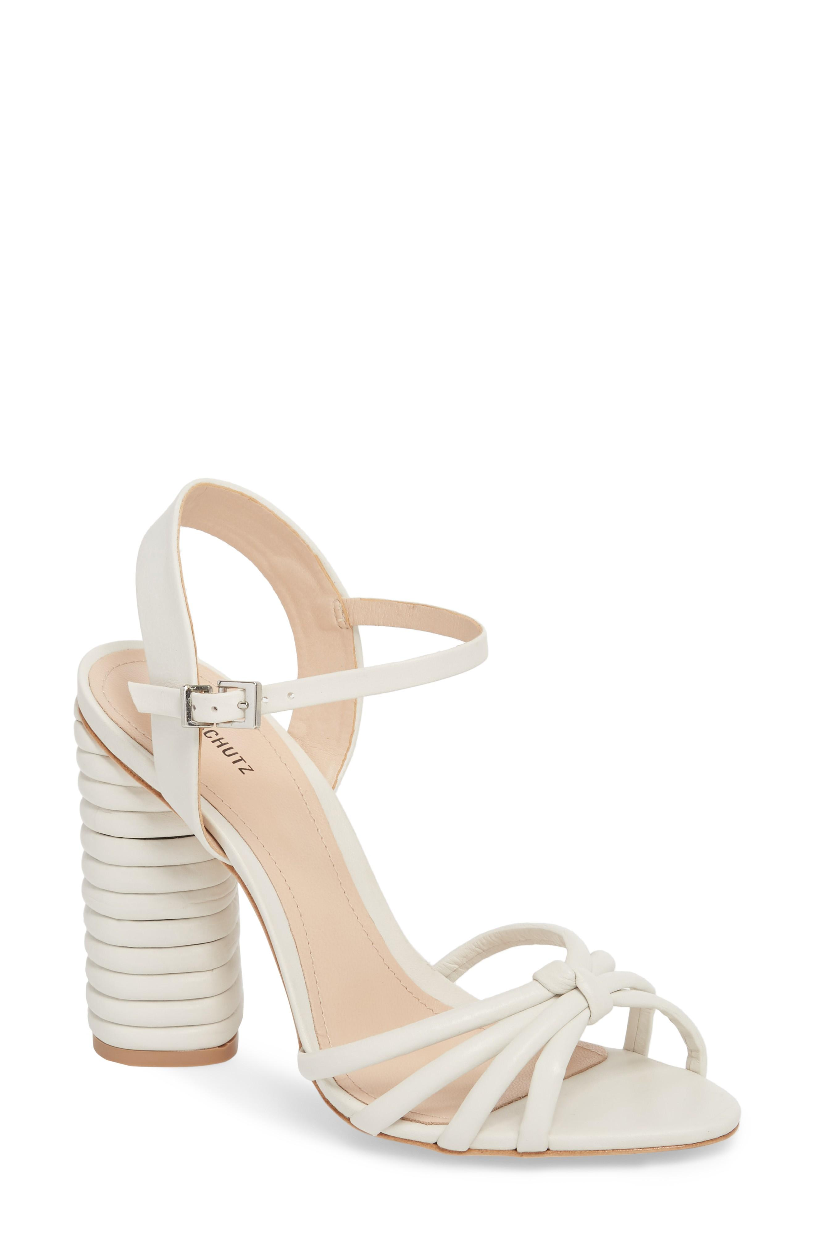 1bac5394f24 A textured column heel and tubular toe-straps add modern intrigue to this  strappy and sophisticated sandal. Style Name  Schutz Paolla Column Heel  Sandal ...