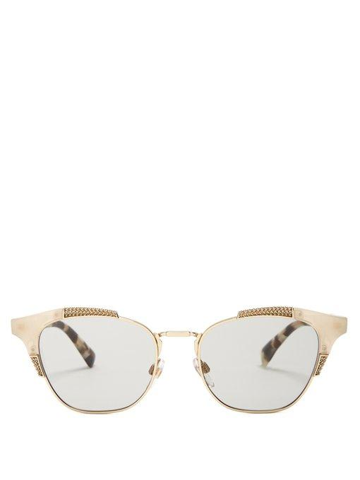 c84c2d8ff1c This Italian-made pair have a pale gold-tone metal framework with  contrasting tonal-brown tortoiseshell arms and sleek grey tinted lenses.