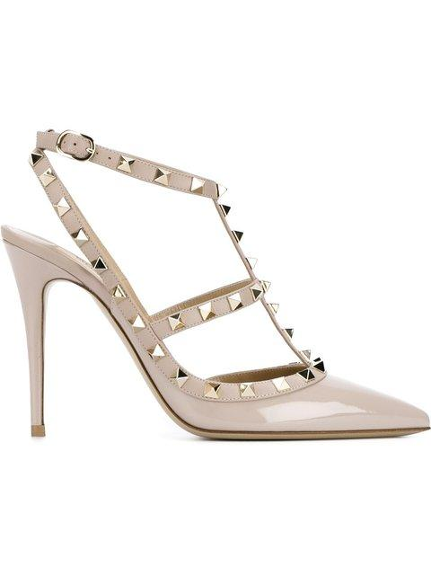 04d7463356e These poudre patent leather Valentino Garavani Rockstud ankle strap pumps  feature a pointed toe