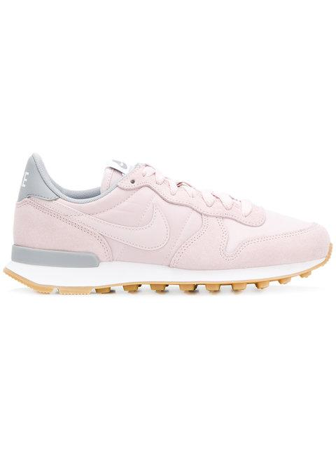 best service d68c9 201d8 Light pink and blue leather Internationalist sneakers from Nike featuring  an almond toe, a lace fastening, a brand embossed tongue, a signature Nike  swoosh, ...