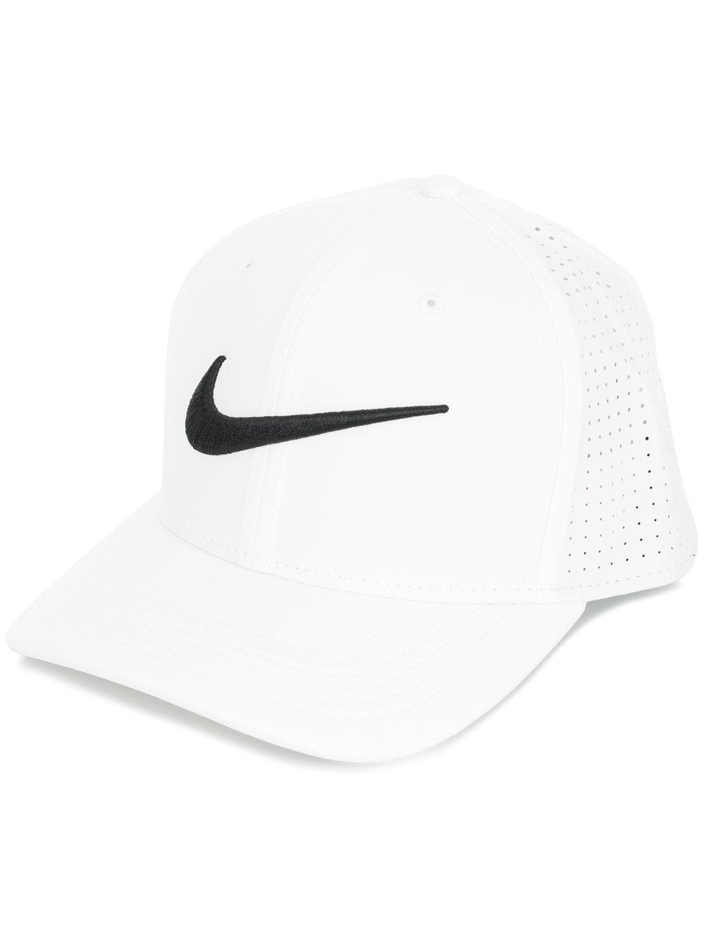 61aebc56654 This olive green camouflage Classic 99 Swoosh Flex cap from Nike features a  curved peak