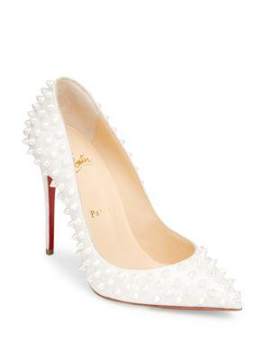 aa07f1dfb199 CHRISTIAN LOUBOUTIN. Follies Spikes 100 Patent Leather Pumps in Latte German  Pearl