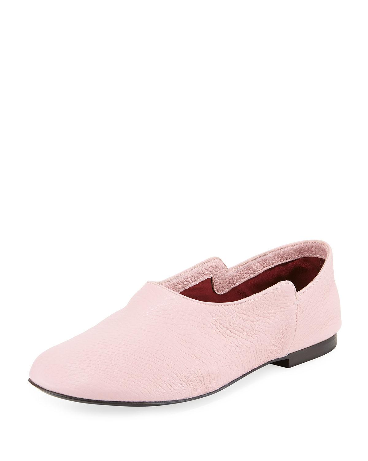 11d9dd8691c The Row s light pink grained leather Boheme loafers are styled with a  rounded toe and lined with ultra-soft satin. This versatile pair features a  fold-down ...