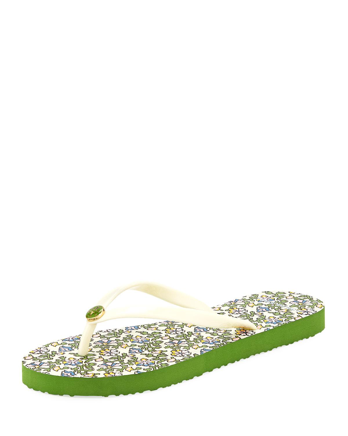 57cb3d58a40944 Answer with the Tory Burch® Thin Flip Flop! Rubber upper material. Slip on  design. Open toe. Thong-style silhouette. Signature brand logo detail.