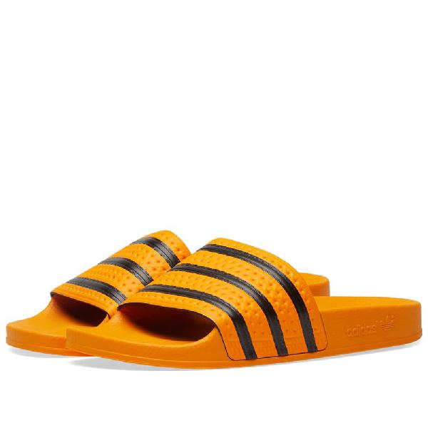 a579ddad3 Adidas Originals Adilette Sliders In Yellow Cq3099 - Yellow In Gold ...