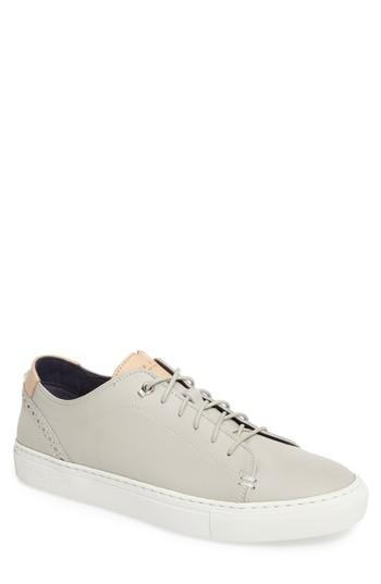 386b5dc1d Burnished leather and cool contrast trim define a classic sneaker stamped  with smart broguing and sleek hardware. Style Name  Ted Baker London  Kiing  ...