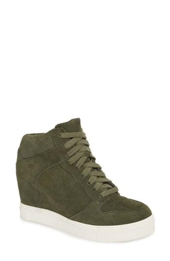 9b78073415a A tall hidden wedge ramps up the flirty attitude of a street-ready suede  sneaker styled with a perforated toe and a sporty bumper cupsole. Style  Name  Steve ...