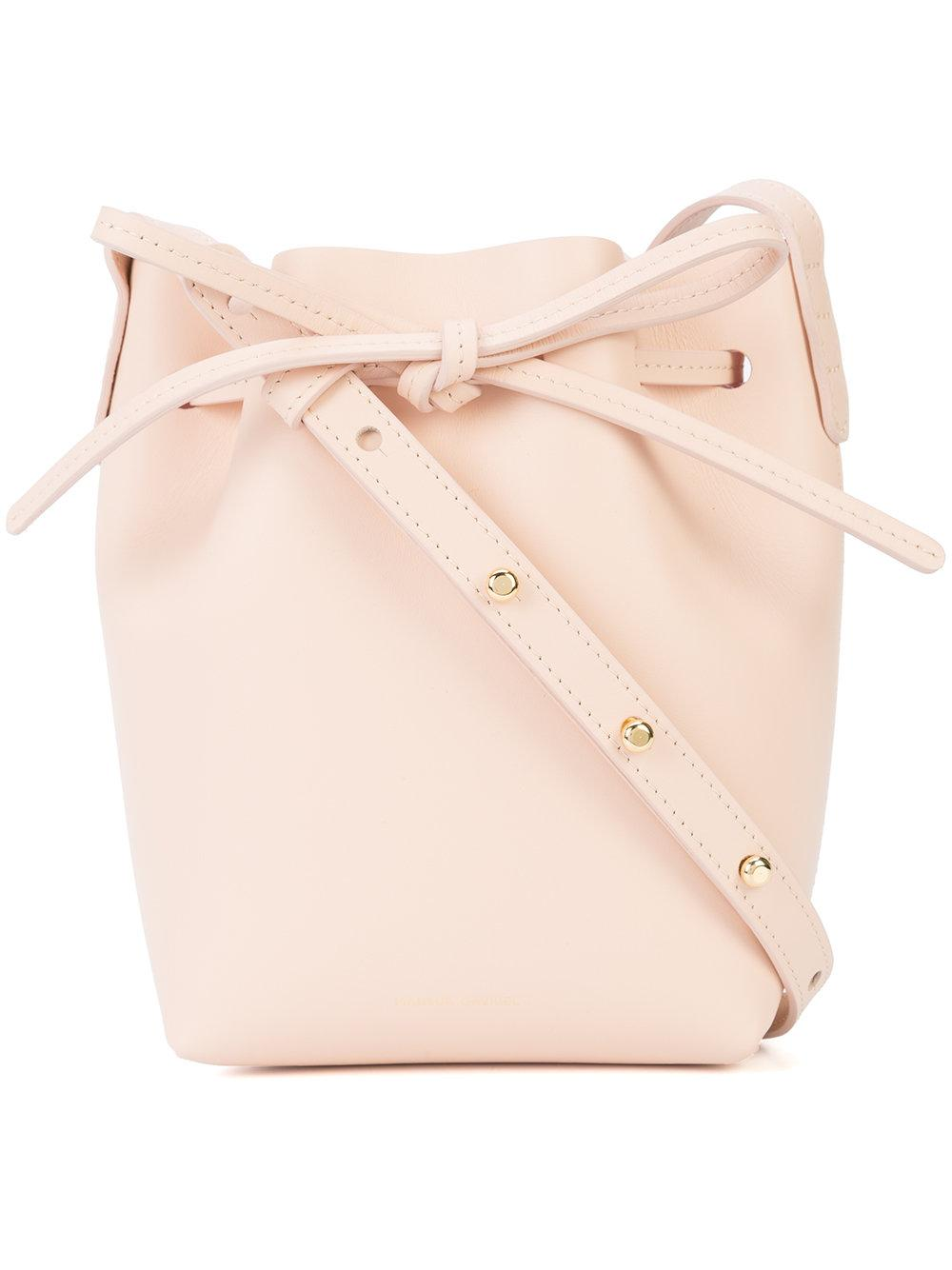 bdf314051f Light pink calf leather Mini Mini Bucket bag from MANSUR GAVRIEL featuring  an adjustable shoulder strap and a drawstring fastening.