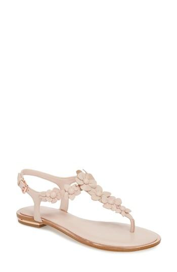 c0709a955b20 Textural blossoms amble up the elegant thong strap of a simple sandal edged  with a glinting reflective accent. Style Name  Michael Michael Kors Tricia  ...
