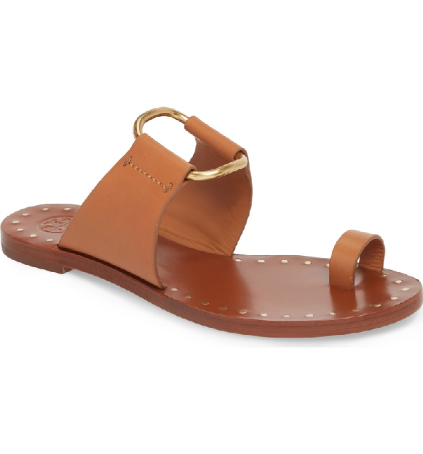 5060011893bc Gilded openwork hardware and nail-head footbed studs highlight the  minimalist styling of this toe-ring sandal. Style Name  Tory Burch Brannan  Studded Sandal ...