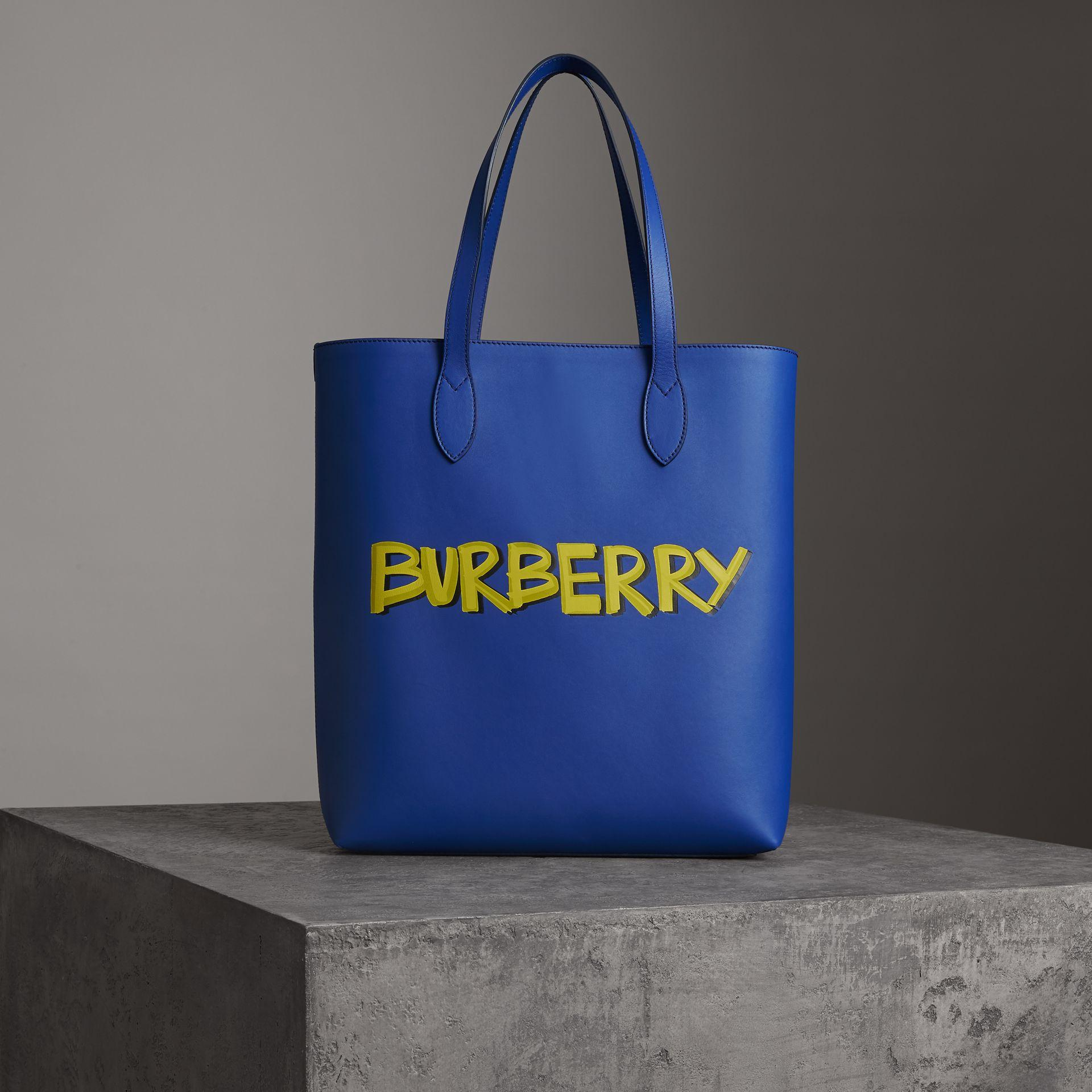 2d3e81ba6153 Burberry Graffiti Print Bonded Leather Tote In Denim Blue