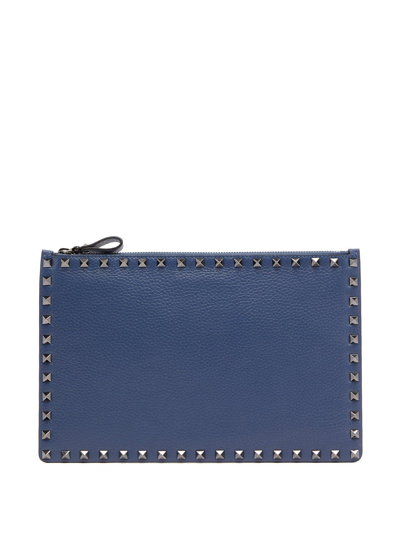 9e8f236f3c01 Valentino Rockstud Pebbled-Leather Pouch In Indigo | ModeSens