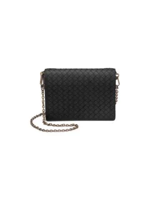 2a772465965b6 Basket weave texture offers rustic accents to leather wallet. Removable  chain shoulder strap. Snap-button flap closure. Goldtone hardware