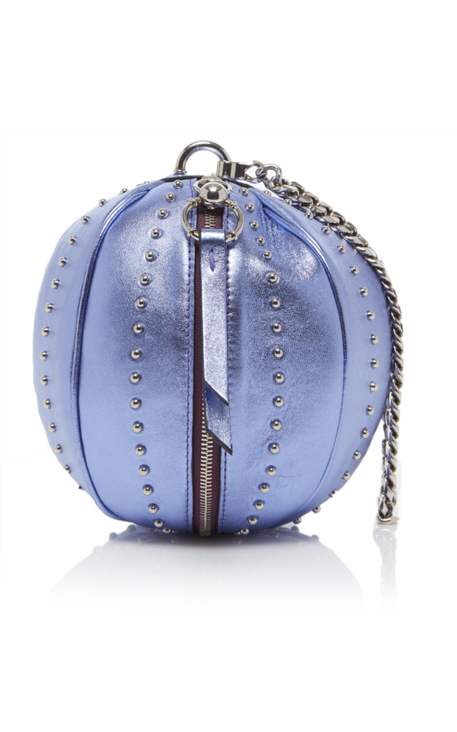 c7db9680af7 This *Balmain* bag is rendered in laminated lambskin and features crossbody  chain strap and studded detail.