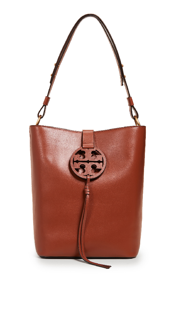 f11828b95655 A signature logo tassel elevates a sleek and sophisticated hobo bag crafted  from smooth calfskin leather accented with golden hardware.