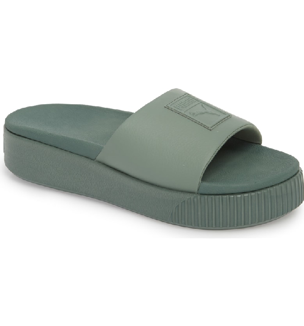 0a92f80bc A signature logo brands the wide strap of a sporty platform slide fitted  with a cushy footbed for all-day comfort. Style Name  Puma Platform Slide ( Women).