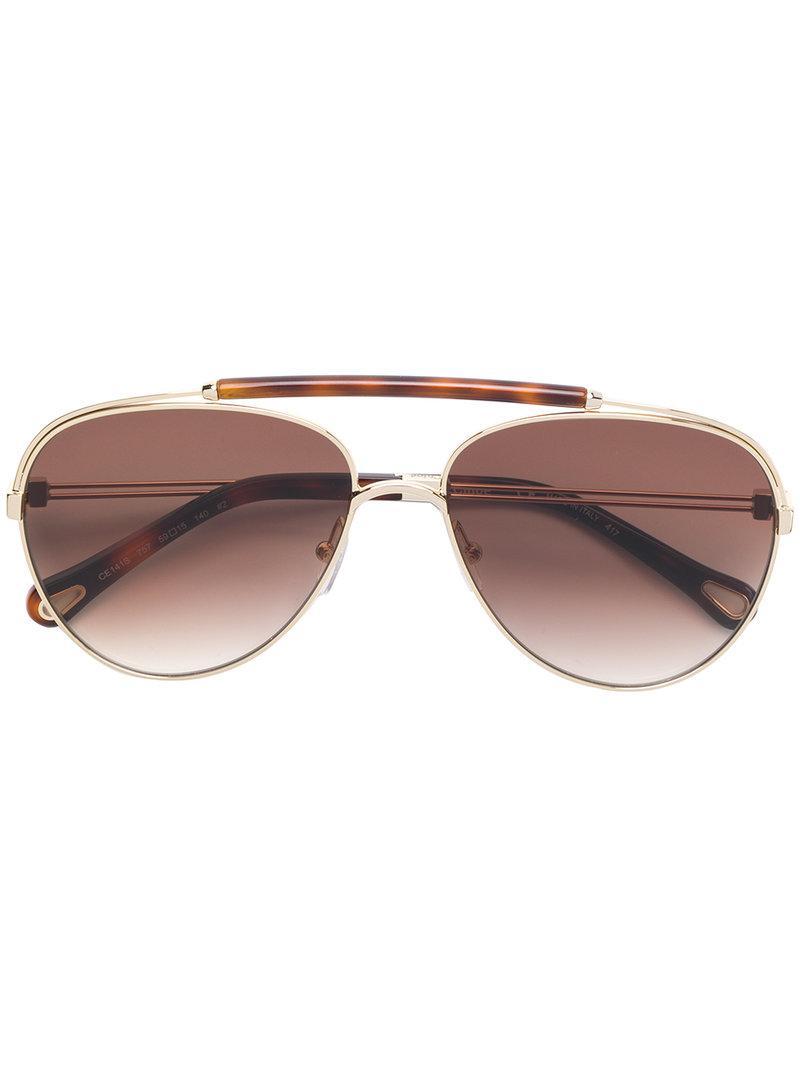0762699de03 Gold metal aviator sunglasses from Chloé Eyewear featuring aviator frames