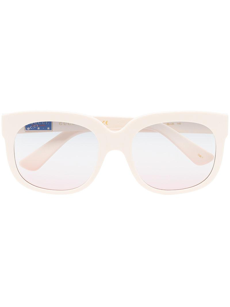 e35f5c82323 Cream classic mass-shape sunglasses from Gucci Eyewear featuring wayfarer  frames
