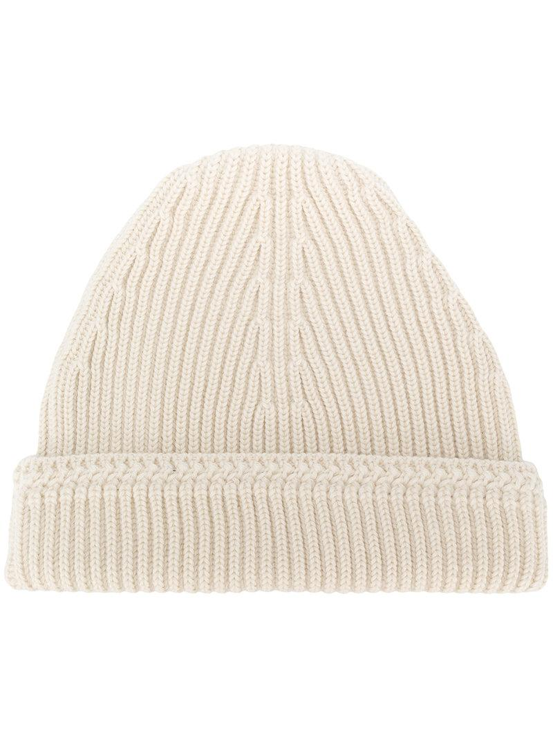 6d2383969bc Opt for all-day comfort this season with Maison Margiela s knitted ribbed  beanie. Constructed in Italy from soft wool in a flattering off-white  shade