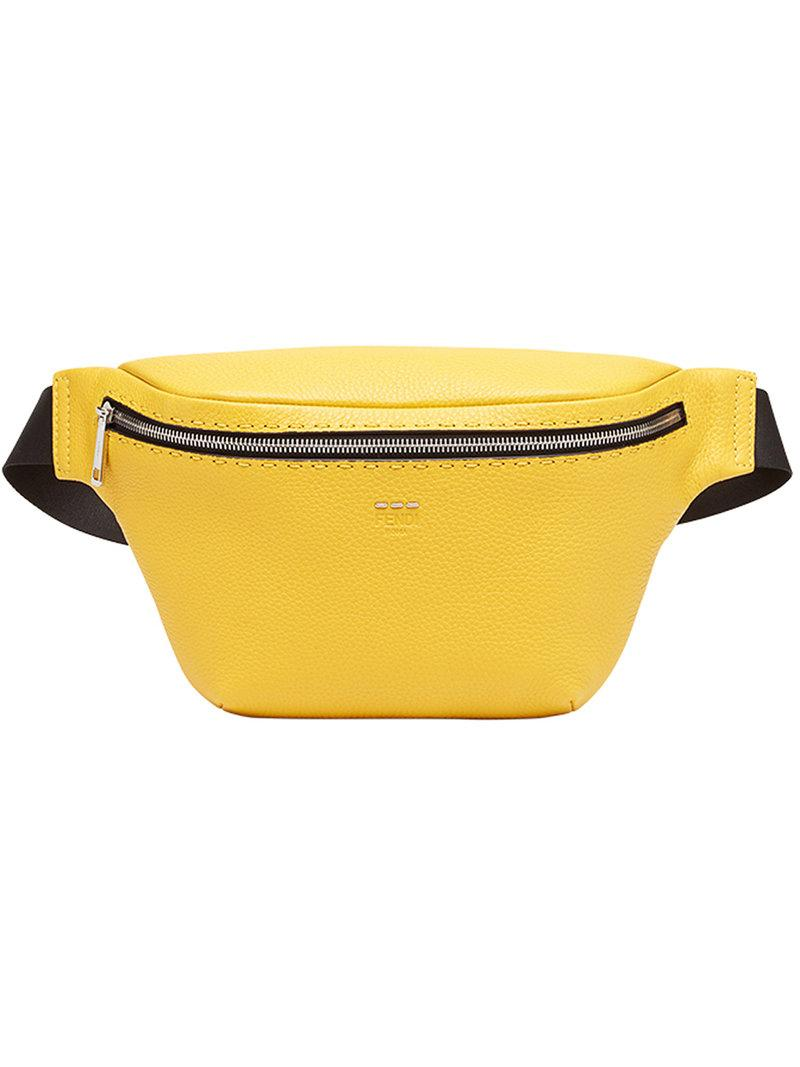 7d1ba240416 Sunflower yellow and black calf leather and cotton-blend belt bag from Fendi  featuring a trapeze body