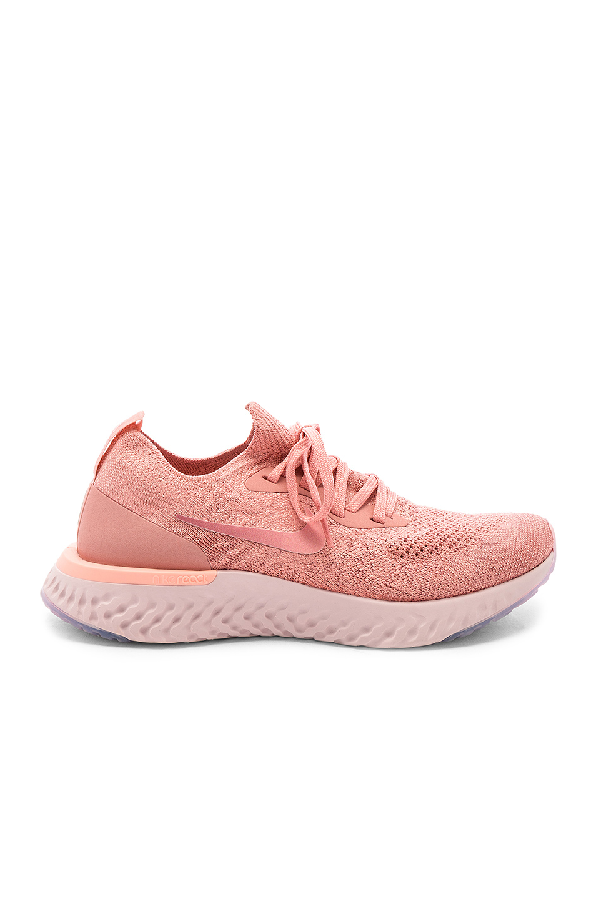 buy online a4f4f aa14b Nike Women s Epic React Flyknit Running Shoes, Pink. SIZE   FIT INFORMATION
